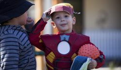 Image of young boy dressed as Iron Man