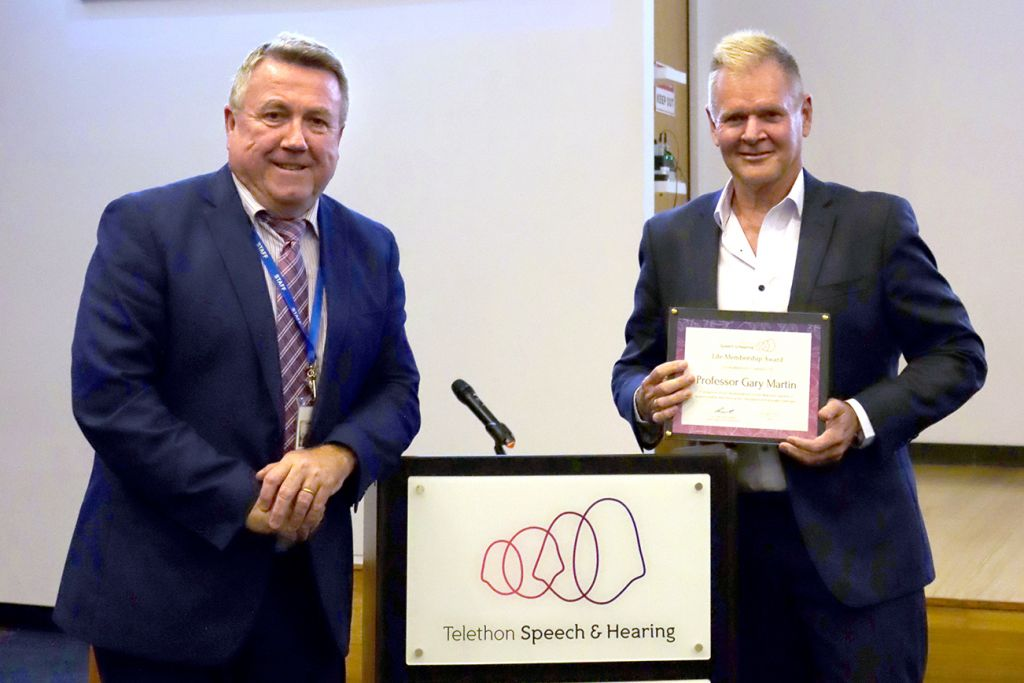 Alec O'Connell presenting Gary Martin with an Honorary Life Membership